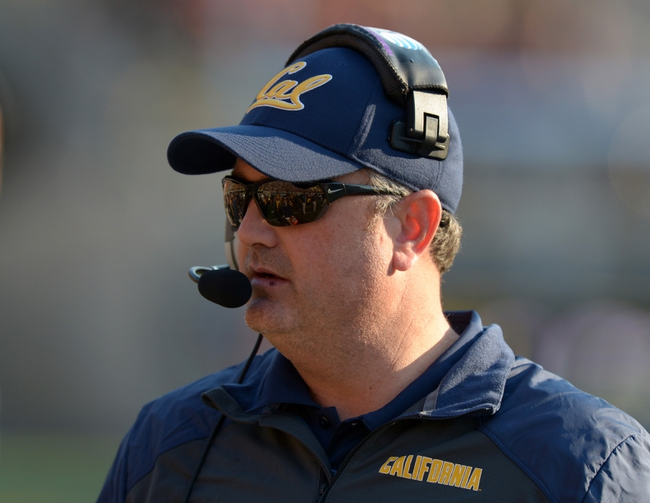 Nov 9, 2013; Berkeley, CA, USA; California Golden Bears coach Sonny Dykes reacts during the game against the Southern California Trojans at Memorial Stadium. USC defeated California 62-28. Mandatory Credit: Kirby Lee-USA TODAY Sports
