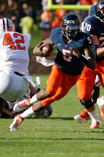 Nov 2, 2013; Charlottesville, VA, USA; Virginia Cavaliers quarterback David Watford (5) carries the ball against the Clemson Tigers at Scott Stadium. Mandatory Credit: Geoff Burke-USA TODAY Sports