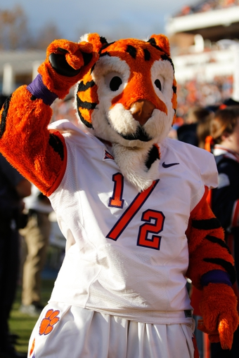 "Nov 2, 2013; Charlottesville, VA, USA; Clemson Tigers mascot ""1/2 cub"" cheers on the sidelines against the Virginia Cavaliers at Scott Stadium. Mandatory Credit: Geoff Burke-USA TODAY Sports"
