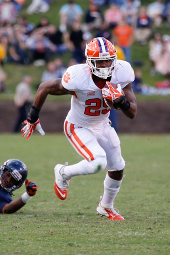 Nov 2, 2013; Charlottesville, VA, USA; Clemson Tigers running back Roderick McDowell (25) carries the ball against the Virginia Cavaliers at Scott Stadium. Mandatory Credit: Geoff Burke-USA TODAY Sports