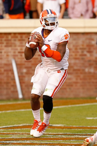 Nov 2, 2013; Charlottesville, VA, USA; Clemson Tigers quarterback Tajh Boyd (10) prepares to throw the ball against the Virginia Cavaliers at Scott Stadium. Mandatory Credit: Geoff Burke-USA TODAY Sports
