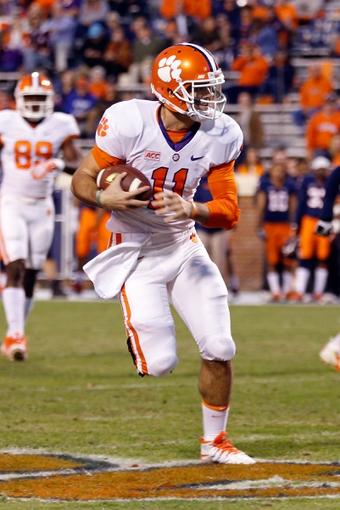Nov 2, 2013; Charlottesville, VA, USA; Clemson Tigers quarterback Chad Kelly (11) runs with the ball against the Virginia Cavaliers at Scott Stadium. Mandatory Credit: Geoff Burke-USA TODAY Sports