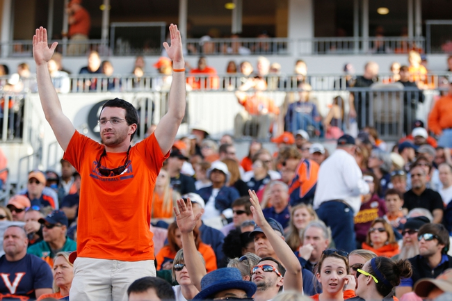Nov 2, 2013; Charlottesville, VA, USA; A Clemson Tigers fan cheers in the stands against the Virginia Cavaliers at Scott Stadium. Mandatory Credit: Geoff Burke-USA TODAY Sports