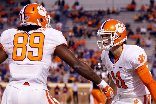 Nov 2, 2013; Charlottesville, VA, USA; Clemson Tigers quarterback Chad Kelly (11) celebrates after scoring a touchdown against the Virginia Cavaliers at Scott Stadium. Mandatory Credit: Geoff Burke-USA TODAY Sports