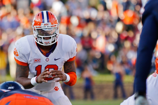 Nov 2, 2013; Charlottesville, VA, USA; Clemson Tigers quarterback Tajh Boyd (10) prepares to take a snap against the Virginia Cavaliers at Scott Stadium. Mandatory Credit: Geoff Burke-USA TODAY Sports