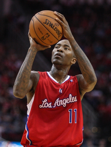 Nov 9, 2013; Houston, TX, USA; Los Angeles Clippers shooting guard Jamal Crawford (11) attempts a free throw during the firth quarter against the Houston Rockets at Toyota Center. Mandatory Credit: Troy Taormina-USA TODAY Sports
