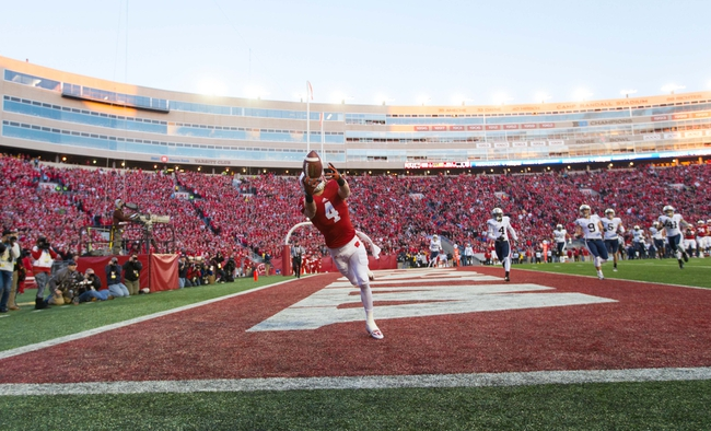 Nov 9, 2013; Madison, WI, USA; Wisconsin Badgers wide receiver Jared Abbrederis (4) reaches for a pass during the game against the Brigham Young Cougars at Camp Randall Stadium. Wisconsin won 27-17.  Mandatory Credit: Jeff Hanisch-USA TODAY Sports