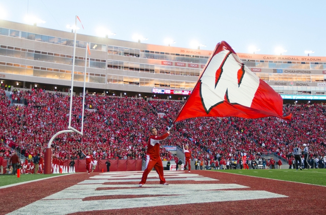Nov 9, 2013; Madison, WI, USA; A Wisconsin Badgers cheerleader performs during the game against the Brigham Young Cougars at Camp Randall Stadium. Wisconsin won 27-17.  Mandatory Credit: Jeff Hanisch-USA TODAY Sports