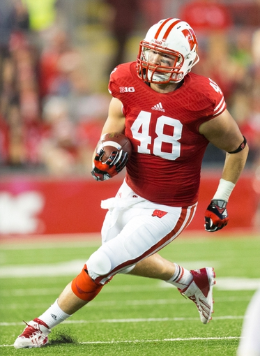 Nov 9, 2013; Madison, WI, USA; Wisconsin Badgers tight end Jacob Pedersen (48) during the game against the Brigham Young Cougars at Camp Randall Stadium. Wisconsin won 27-17.  Mandatory Credit: Jeff Hanisch-USA TODAY Sports