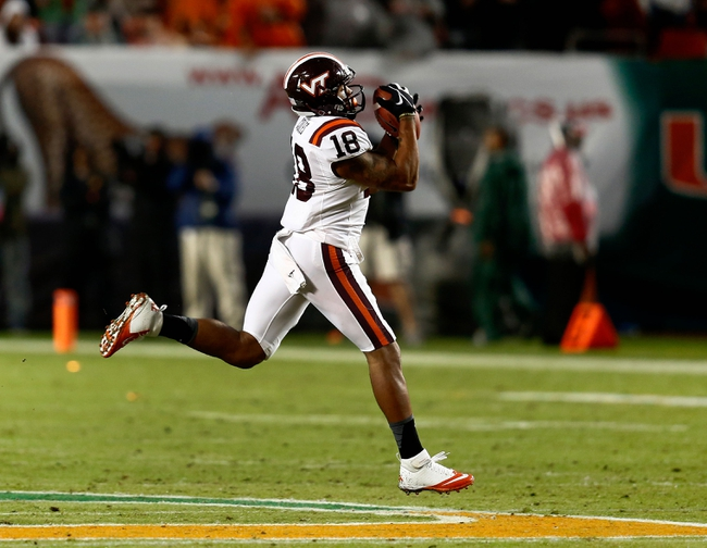 Nov 9, 2013; Miami Gardens, FL, USA;  Virginia Tech Hokies wide receiver D.J. Coles (18) catches a pass in the first quarter of a game against the Miami Hurricanes against at Sun Life Stadium. Mandatory Credit: Robert Mayer-USA TODAY Sports