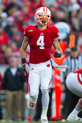 Nov 9, 2013; Madison, WI, USA; Wisconsin Badgers wide receiver Jared Abbrederis (4) during the game against the Brigham Young Cougars at Camp Randall Stadium. Wisconsin won 27-17.  Mandatory Credit: Jeff Hanisch-USA TODAY Sports