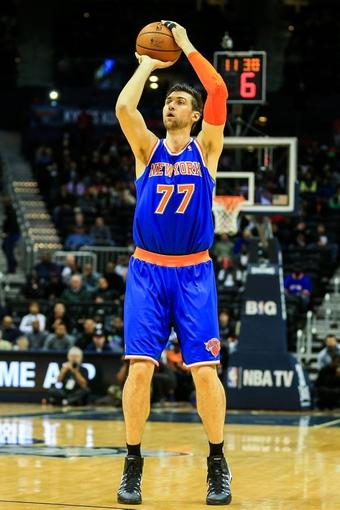 Nov 13, 2013; Atlanta, GA, USA; New York Knicks power forward Andrea Bargnani (77) shoots a three in the first quarter against the Atlanta Hawks at Philips Arena. Mandatory Credit: Daniel Shirey-USA TODAY Sports