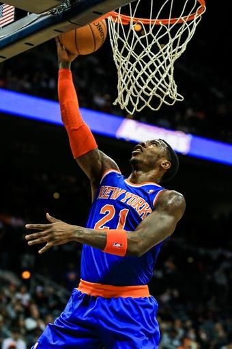 Nov 13, 2013; Atlanta, GA, USA; New York Knicks shooting guard Iman Shumpert (21) shoots a basket in the first quarter against the Atlanta Hawks at Philips Arena. Mandatory Credit: Daniel Shirey-USA TODAY Sports