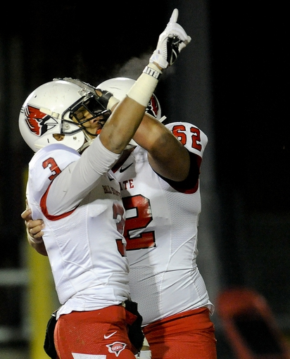 Nov 13, 2013; DeKalb, IL, USA; Ball State Cardinals player Willie Snead (3) gets congratulated by teammate Jacob Richard (62) after scoring a touchdown against Northern Illinois Cardinals during the 1st quarter against  at Huskie Stadium. Mandatory Credit: Matt Marton-USA TODAY Sports