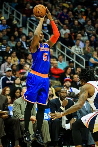 Nov 13, 2013; Atlanta, GA, USA; New York Knicks small forward Metta World Peace (51) shoots a three in the first half against the Atlanta Hawks at Philips Arena. Mandatory Credit: Daniel Shirey-USA TODAY Sports