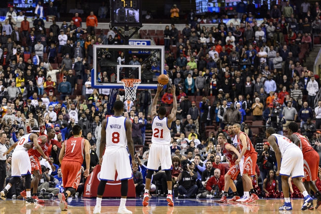 Nov 13, 2013; Philadelphia, PA, USA; Philadelphia 76ers forward Thaddeus Young (21) makes a foul shot with 7.1 seconds left in overtime against the Houston Rockets at Wells Fargo Center. The Sixers defeated the Rockets 123-117. Mandatory Credit: Howard Smith-USA TODAY Sports