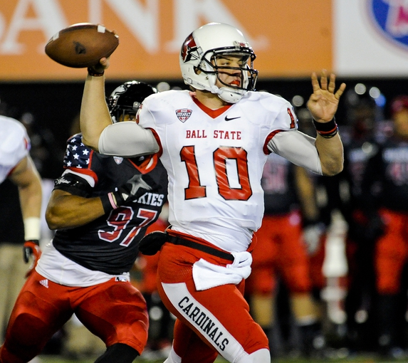 Nov 13, 2013; DeKalb, IL, USA; Ball State Huskies quarterback Keith Wenning (13) throws against Northern Illinois Cardinals during the 1st quarter at Huskie Stadium. Mandatory Credit: Matt Marton-USA TODAY Sports