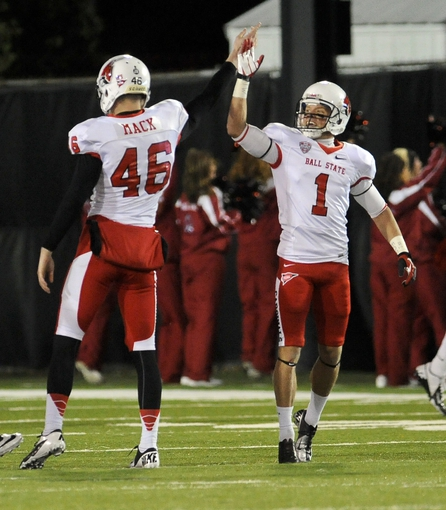 Nov 13, 2013; DeKalb, IL, USA; Ball State Huskies place kicker Scott Secor high fives Garrett Mack (46) after a field goal against Northern Illinois Cardinals during the 2nd quarter at Huskie Stadium. Mandatory Credit: Matt Marton-USA TODAY Sports