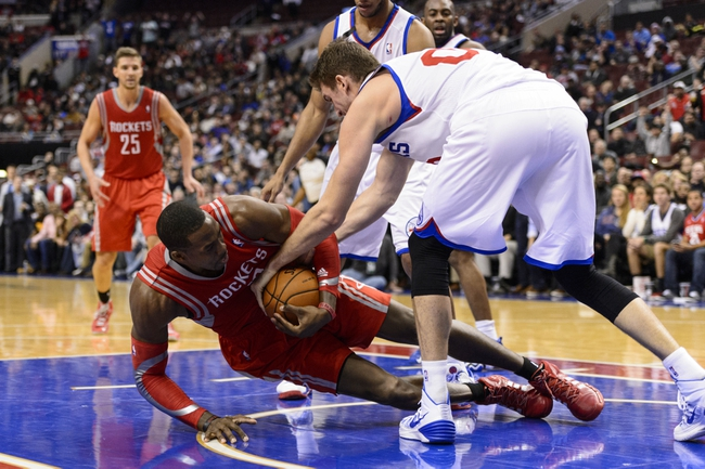 Nov 13, 2013; Philadelphia, PA, USA; Philadelphia 76ers center Spencer Hawes (00) battles for the ball with Houston Rockets forward Dwight Howard (12) during the fourth quarter at Wells Fargo Center. The Sixers defeated the Rockets 123-117. Mandatory Credit: Howard Smith-USA TODAY Sports