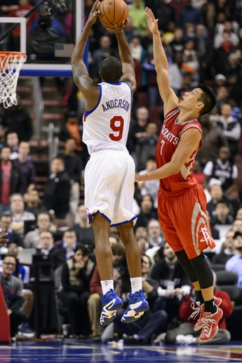 Nov 13, 2013; Philadelphia, PA, USA; Philadelphia 76ers guard James Anderson (9) shoots a jump shot under pressure from Houston Rockets guard Jeremy Lin (7) during the fourth quarter at Wells Fargo Center. The Sixers defeated the Rockets 123-117. Mandatory Credit: Howard Smith-USA TODAY Sports