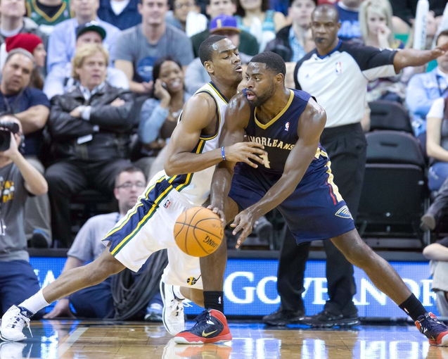 Nov 13, 2013; Salt Lake City, UT, USA; New Orleans Pelicans point guard Tyreke Evans (1) is defended by Utah Jazz point guard Alec Burks (10) during the first half at EnergySolutions Arena. Mandatory Credit: Russ Isabella-USA TODAY Sports