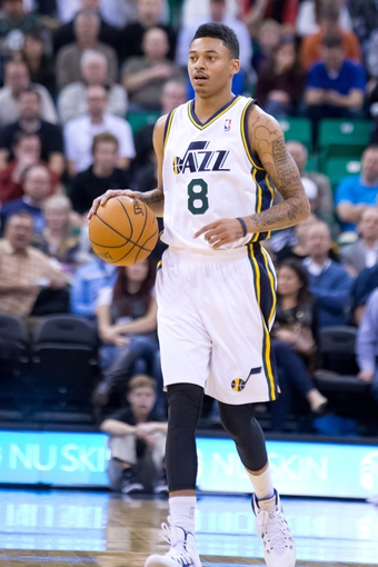 Nov 13, 2013; Salt Lake City, UT, USA; Utah Jazz guard Diante Garrett (8) dribbles up the court during the first half against the New Orleans Pelicans at EnergySolutions Arena. Mandatory Credit: Russ Isabella-USA TODAY Sports
