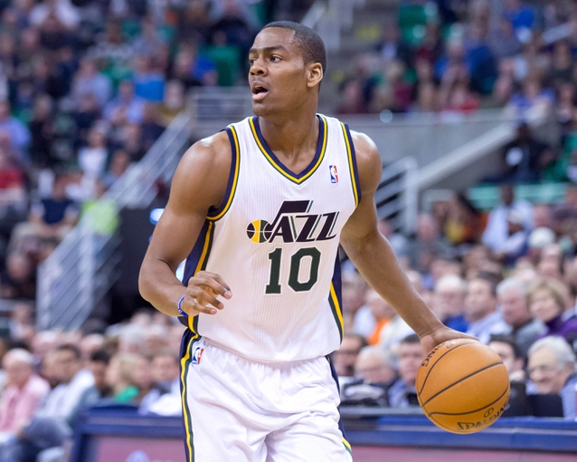 Nov 13, 2013; Salt Lake City, UT, USA; Utah Jazz point guard Alec Burks (10) controls the ball during the first half against the New Orleans Pelicans at EnergySolutions Arena. Mandatory Credit: Russ Isabella-USA TODAY Sports
