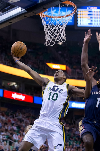 Nov 13, 2013; Salt Lake City, UT, USA; Utah Jazz point guard Alec Burks (10) goes to the basket during the first half against the New Orleans Pelicans at EnergySolutions Arena. Mandatory Credit: Russ Isabella-USA TODAY Sports