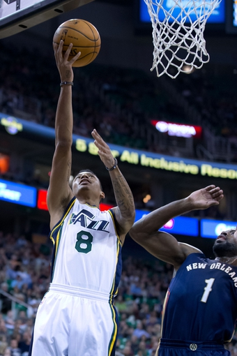 Nov 13, 2013; Salt Lake City, UT, USA; Utah Jazz guard Diante Garrett (8) shoots during the first half against the New Orleans Pelicans at EnergySolutions Arena. Mandatory Credit: Russ Isabella-USA TODAY Sports