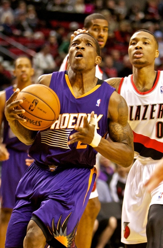 Nov 13, 2013; Portland, OR, USA; Phoenix Suns point guard Eric Bledsoe (2) drives to the basket past Portland Trail Blazers point guard Damian Lillard (0) at the Moda Center. Mandatory Credit: Craig Mitchelldyer-USA TODAY Sports