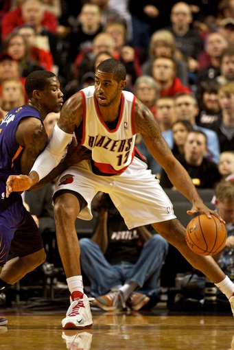 Nov 13, 2013; Portland, OR, USA; Portland Trail Blazers power forward LaMarcus Aldridge (12) posts up against Phoenix Suns point guard Eric Bledsoe (2) at the Moda Center. Mandatory Credit: Craig Mitchelldyer-USA TODAY Sports