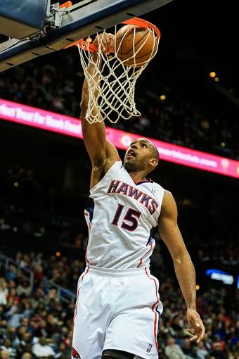 Nov 13, 2013; Atlanta, GA, USA; Atlanta Hawks center Al Horford (15) dunks in the second half against the New York Knicks at Philips Arena. The Knicks won 95-91. Mandatory Credit: Daniel Shirey-USA TODAY Sports