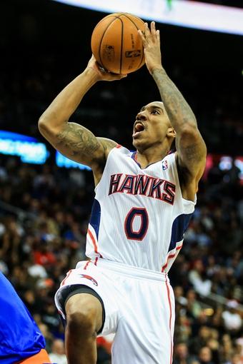 Nov 13, 2013; Atlanta, GA, USA; Atlanta Hawks point guard Jeff Teague (0) shoots a basket in the second half against the New York Knicks at Philips Arena. The Knicks won 95-91. Mandatory Credit: Daniel Shirey-USA TODAY Sports