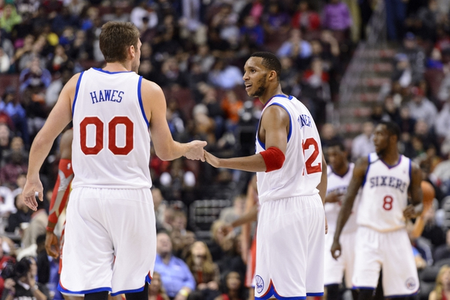 Nov 13, 2013; Philadelphia, PA, USA; Philadelphia 76ers guard Evan Turner (12) celebrates with center Spencer Hawes (00) during the fourth quarter against the Houston Rockets at Wells Fargo Center. The Sixers defeated the Rockets 123-117. Mandatory Credit: Howard Smith-USA TODAY Sports