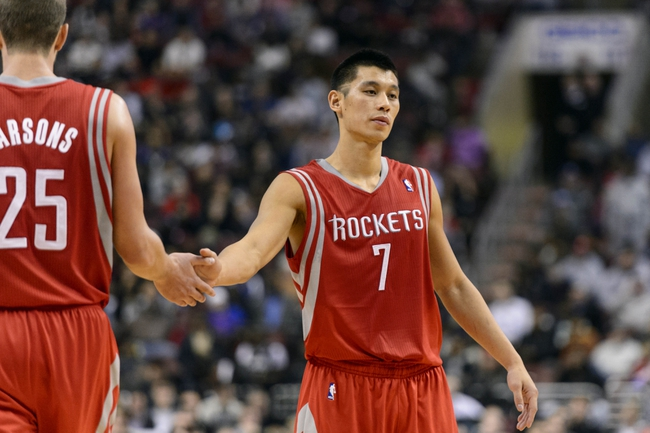 Nov 13, 2013; Philadelphia, PA, USA; Houston Rockets guard Jeremy Lin (7) celebrates with forward Chandler Parsons (25) during the fourth quarter against the Philadelphia 76ers at Wells Fargo Center. The Sixers defeated the Rockets 123-117. Mandatory Credit: Howard Smith-USA TODAY Sports