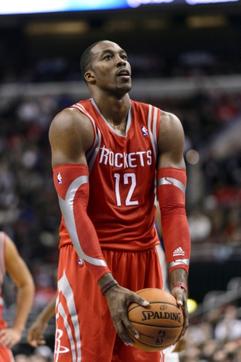 Nov 13, 2013; Philadelphia, PA, USA; Houston Rockets forward Dwight Howard (12) about to shoot a foul shot during overtime against the Philadelphia 76ers at Wells Fargo Center. The Sixers defeated the Rockets 123-117. Mandatory Credit: Howard Smith-USA TODAY Sports