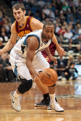 Nov 13, 2013; Minneapolis, MN, USA; Minnesota Timberwolves point guard A.J. Price (22) dribbles in the fourth quarter against the Cleveland Cavaliers at Target Center. Mandatory Credit: Brad Rempel-USA TODAY Sports. The Minnesota Timberwolves win 124-95.