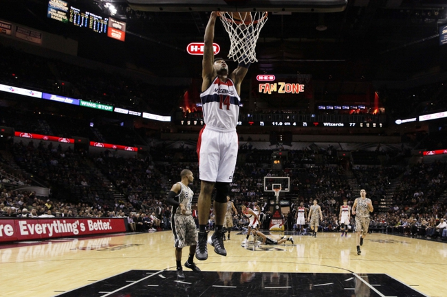 Nov 13, 2013; San Antonio, TX, USA; Washington Wizards guard Glen Rice (14) dunks the ball during the second half against the San Antonio Spurs at AT&T Center. The Spurs won 92-79. Mandatory Credit: Soobum Im-USA TODAY Sports