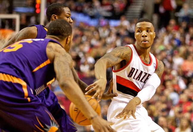 Nov 13, 2013; Portland, OR, USA; Portland Trail Blazers point guard Damian Lillard (0) passes the ball against the Phoenix Suns at the Moda Center. Mandatory Credit: Craig Mitchelldyer-USA TODAY Sports