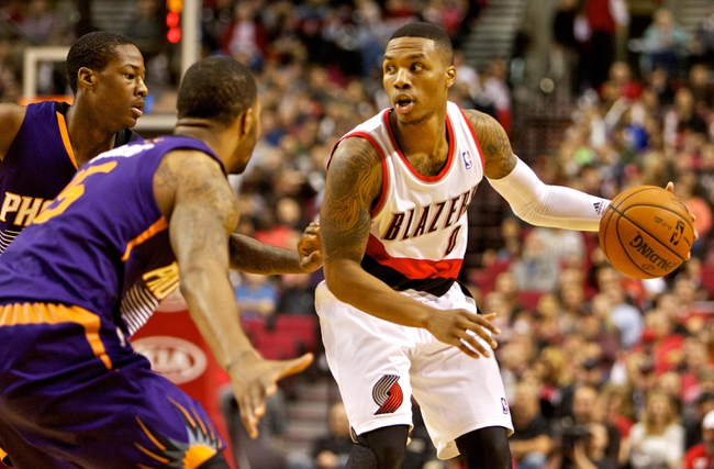 Nov 13, 2013; Portland, OR, USA; Portland Trail Blazers point guard Damian Lillard (0) looks to pass against the Phoenix Suns at the Moda Center. Mandatory Credit: Craig Mitchelldyer-USA TODAY Sports