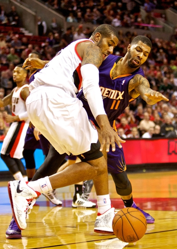 Nov 13, 2013; Portland, OR, USA; Phoenix Suns power forward Markieff Morris (11) knocks the ball away from Portland Trail Blazers power forward LaMarcus Aldridge (12) at the Moda Center. Mandatory Credit: Craig Mitchelldyer-USA TODAY Sports
