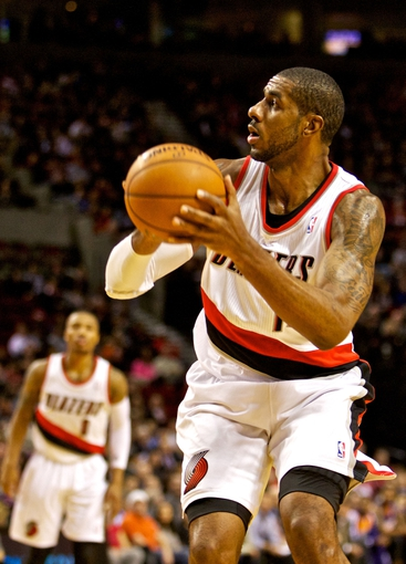 Nov 13, 2013; Portland, OR, USA; Portland Trail Blazers power forward LaMarcus Aldridge (12) shoots against the Phoenix Suns at the Moda Center. Mandatory Credit: Craig Mitchelldyer-USA TODAY Sports