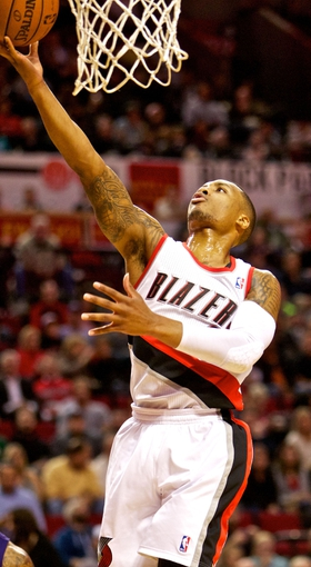 Nov 13, 2013; Portland, OR, USA; Portland Trail Blazers point guard Damian Lillard (0) shoots against the Phoenix Suns at the Moda Center. Mandatory Credit: Craig Mitchelldyer-USA TODAY Sports