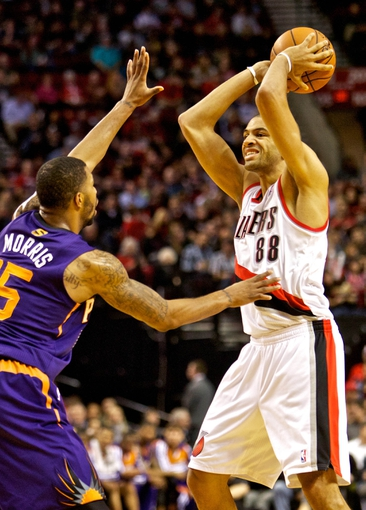 Nov 13, 2013; Portland, OR, USA; Portland Trail Blazers small forward Nicolas Batum (88) looks to pass over Phoenix Suns power forward Marcus Morris (15) at the Moda Center. Mandatory Credit: Craig Mitchelldyer-USA TODAY Sports