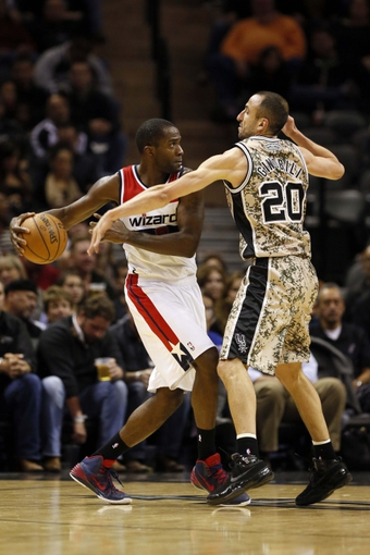 Nov 13, 2013; San Antonio, TX, USA; Washington Wizards forward Martell Webster (left) is defended by San Antonio Spurs guard Manu Ginobili (right) during the second half at AT&T Center. The Spurs won 92-79. Mandatory Credit: Soobum Im-USA TODAY Sports