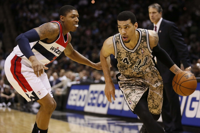 Nov 13, 2013; San Antonio, TX, USA; San Antonio Spurs guard Danny Green (4) drives against Washington Wizards guard Bradley Beal (left) during the second half at AT&T Center. The Spurs won 92-79. Mandatory Credit: Soobum Im-USA TODAY Sports