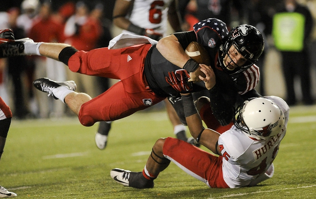 Nov 13, 2013; DeKalb, IL, USA;  Northern Illinois Cardinals quarterback Jordan Lynch (6) leaps into the end zone in the 4th quarter against Ball State Huskies at Huskie Stadium. Mandatory Credit: Matt Marton-USA TODAY Sports