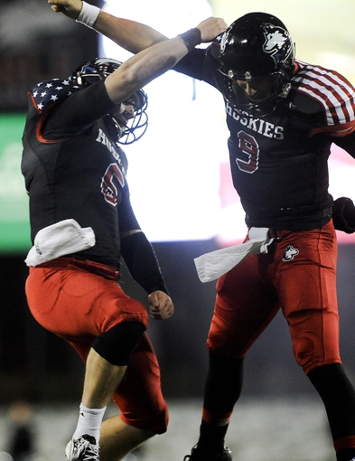 Nov 13, 2013; DeKalb, IL, USA;  Northern Illinois Cardinals quarterback Jordan Lynch (6) and quarterback Matt McIntosh (9) celebrate after scoring a touchdown in the 4th quarter against Ball State Huskies at Huskie Stadium. Mandatory Credit: Matt Marton-USA TODAY Sports