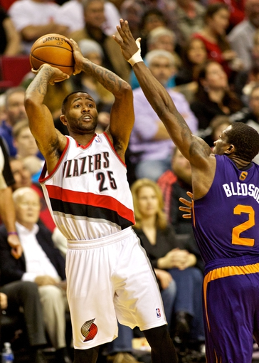 Nov 13, 2013; Portland, OR, USA; Portland Trail Blazers point guard Mo Williams (25) shoots over Portland Trail Blazers shooting guard Wesley Matthews (2) at the Moda Center. Mandatory Credit: Craig Mitchelldyer-USA TODAY Sports