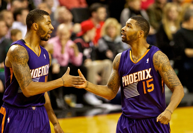 Nov 13, 2013; Portland, OR, USA; Phoenix Suns power forward Marcus Morris (15) and power forward Markieff Morris (11) high five after scoring against the Portland Trail Blazers at the Moda Center. Mandatory Credit: Craig Mitchelldyer-USA TODAY Sports